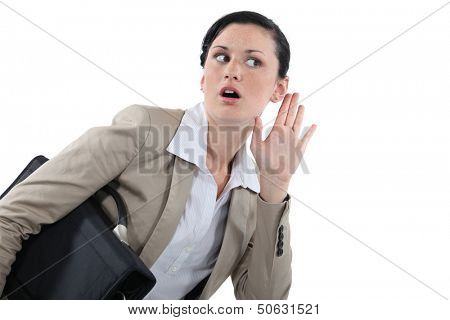 Businesswoman struggling to hear
