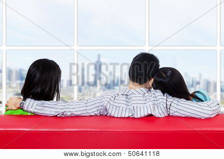 Two Woman And One Man Looking Cityscape