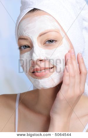 Woman With Cosmetic Mask