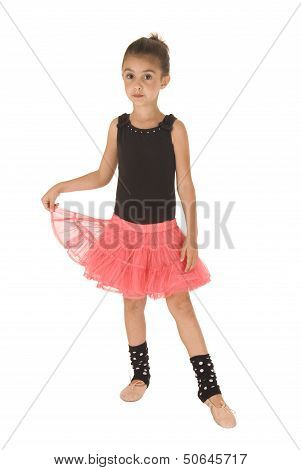 Young Ballerina Girl Holding Up Pink Tutu Toe Forward