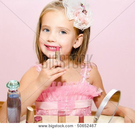 Child Cosmetics  Cute Little Girl With Lipstick