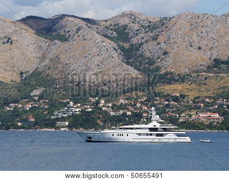 Yacht With Crotia Coast In The Background