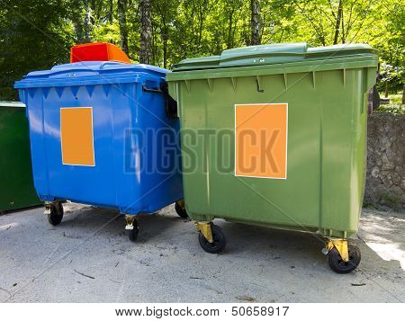 New Colorful Plastic Garbage Containers In Park