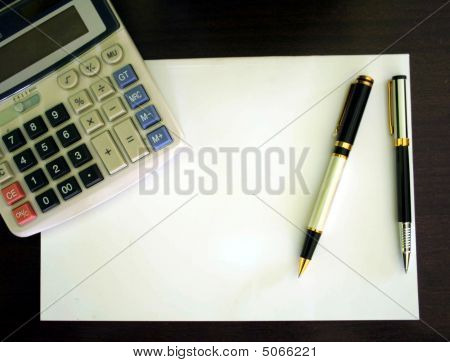 A Calculator, Blank Paper And Pens