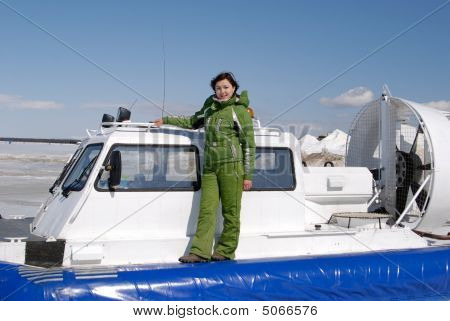 Young girl and hovercraft