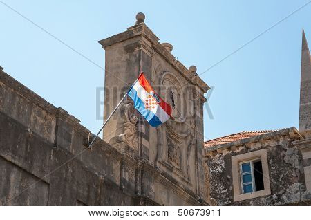 Old clock and croatian flag.
