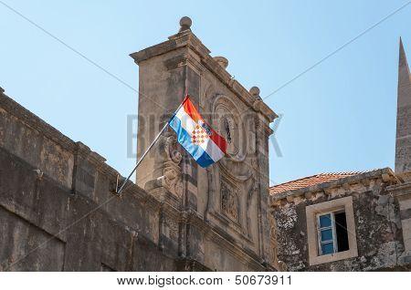 Old clock and croatian flag.