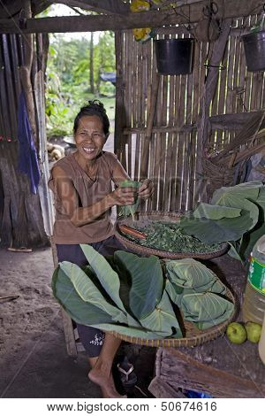 Filipino Woman Prepares Food