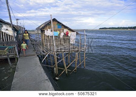 Seaside Home On Poles Over Water