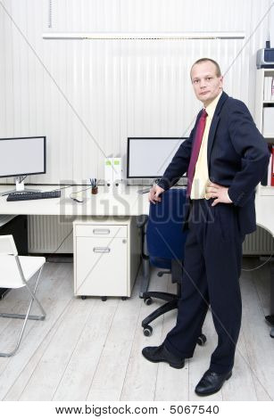 Manager In An Office With Blinds