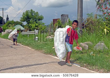 Boys Collecting Trash