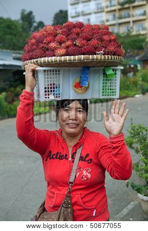 Woman Selling Rambutan Fruit
