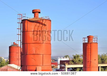 Industrial Landscape With Vermilion Towers