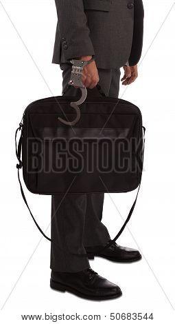 Businessman In Handcuffs Holding Briefcase
