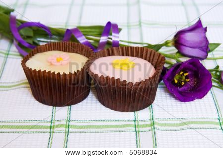 Cupcakes With Purple Spring Flowers And Ribbon