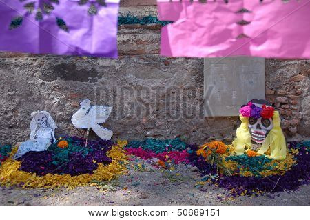 Day of the Dead decorations at gravesite in San Miguel de Allende, Mexico cemetery