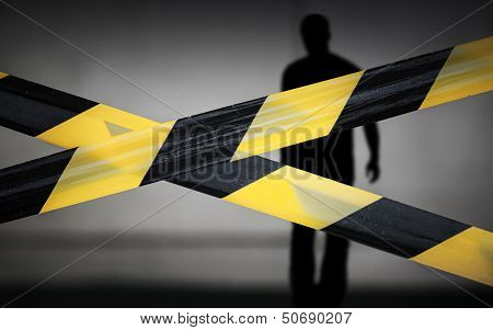 Black And Yellow Striped Tapes And Violator Man Silhouette Behind It