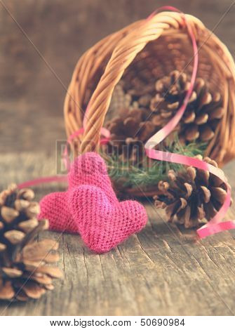 Pine Cones And Handmade Crochet Hearts In Basket