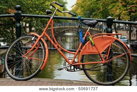 Orange Bike by Amsterdam Canal