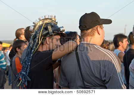 fans of the rock in the crowd on a tank shows Stalingrad