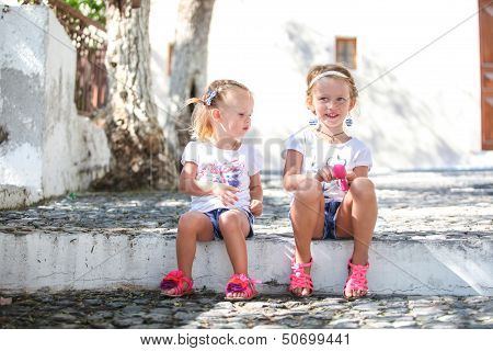Young Charming Girls Walk The Old Greek Village Of Emporio, Santorini