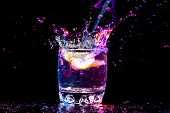 stock photo of cosmopolitan  - colourful coctail on the black background - JPG