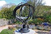 foto of sundial  - steel sundial standing in a garden display - JPG
