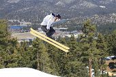 Photo of male skier in the air.