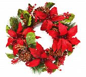 stock photo of poinsettias  - Closeup of artificail christmas wreath with poinsettia flowers and natural pinecones - JPG