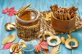 image of cider apples  - Apple cider with cinnamon in a glass