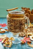 foto of cider apples  - Apple cider with cinnamon in a glass