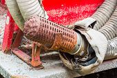 pic of vacuum pump  - Close up rusty pump suction hose with filter - JPG