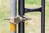 pic of scaffolding  - Close up Swivel Scaffolding Clamp and steel pipe in construction site - JPG