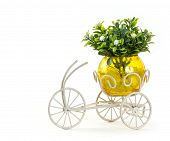 stock photo of tricycle  - Bunch of flower in glass vase on Mini tricycle - JPG