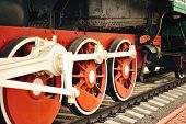 stock photo of locomotive  - Wheel of an old steam locomotive close up - JPG