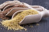 foto of millet  - Close up photo of a eco raw food in the spoon  - JPG