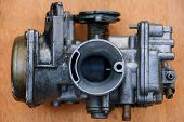 stock photo of carburetor  - spare motor parts of motorcycle is preparing to repair - JPG