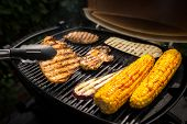 Steaks and Corn Cob on Grill