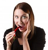 picture of chillies  - Pretty young woman eating hot chilli peppers - JPG