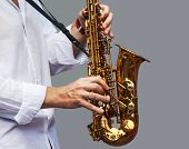 stock photo of saxophone player  - hands of a musician playing the saxophone - JPG