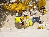 stock photo of personal safety  - Construction worker has an accident while working on new house - JPG