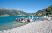 picture of south tyrol  - Excursion Boat and Pier at Reschensee Reservoir - JPG