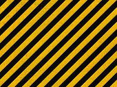 image of hazard symbol  - Seamless background pattern with yellow and black diagonal lines on concrete wall - JPG