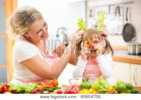 Mother And Kid Cooking And Having Fun In Kitchen