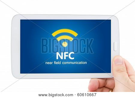 Hand Holding Tablet With NFC chip