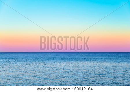 Pastel Sky With A Calm Sea Beneath
