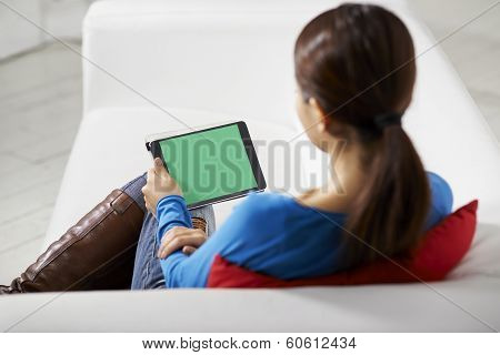 Asian Girl Using Touch Pad Device
