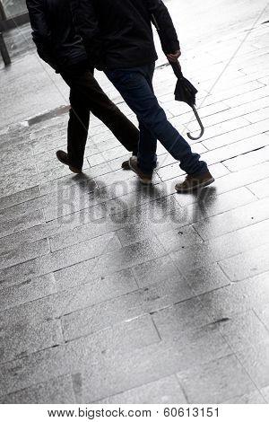 Walking along a cobblestone street, Old City Madrid, Spain