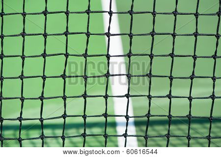 tennis courts with net and green surface