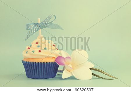 Retro vintage old fashion style fancy cupcake with orchid